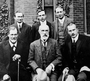 Analytic Frat Bros.  Sigmund Freud (L) sitting at opposite ends from Carl Jung (R) at Clark University in 1909.  Photo Credit:  Wikimedia Commons, Public Domain.